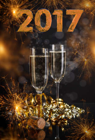two years: 2017 New Years Eve celebration background with pair of flutes