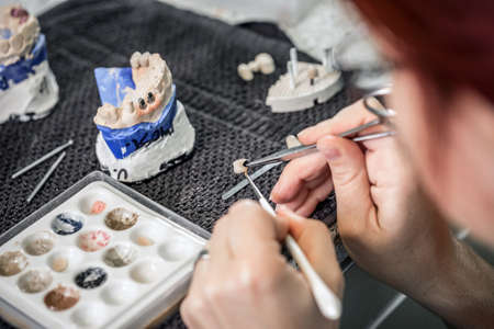 tooth crown: Dental technician paint a tooth crown, dental concept