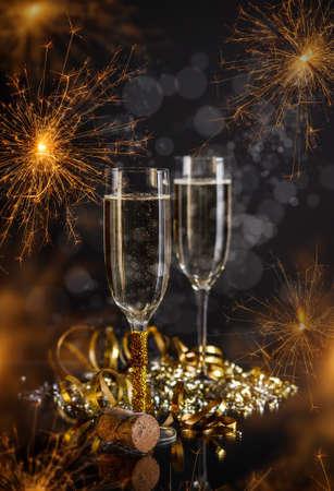 holydays: Champagne glasses on festive sparkler background Stock Photo