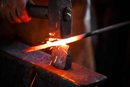 The hands of a blacksmith at work in the smithy Stock Photo