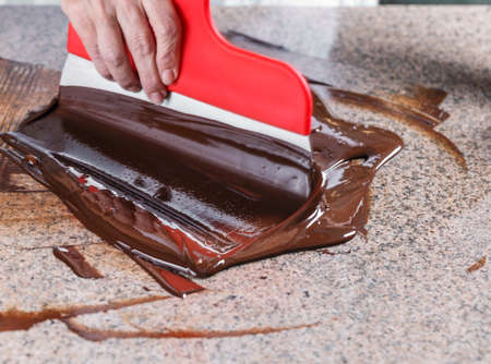 hot temper: Tempering of the chocolate on the marble surface