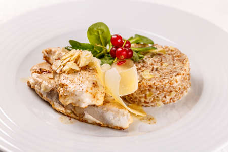 Grilled sablefish or butterfish serving with arpacas (husking and refining wheat, spelt, barley or millet)