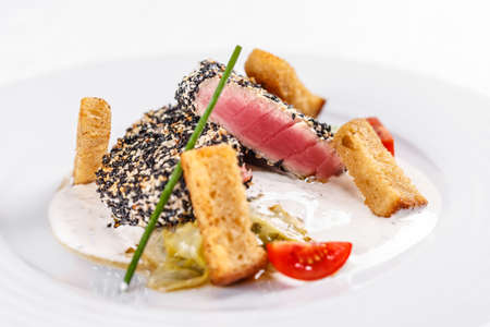 roasted sesame: Still life of roasted tuna steaks crusted with sesame seeds