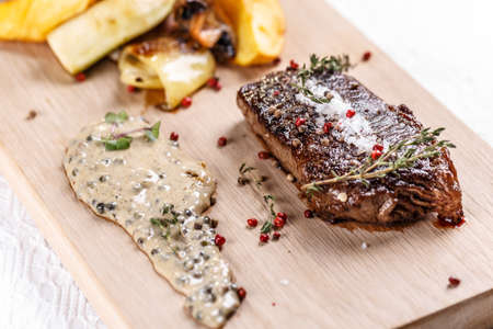 beefsteaks: Fresh beef steak with grilled vegetables and mustar sauce