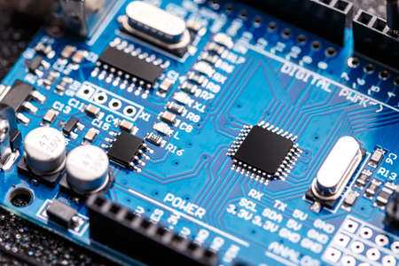 semiconductor: Integrated semiconductor microchip microprocessor on blue circuit board