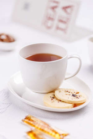 o'clock: Cup of tea with biscuits, 5 oclock tea Stock Photo