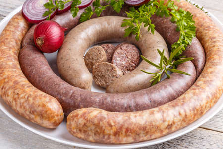 british cuisine: Home made black pudding, white pudding and sausage