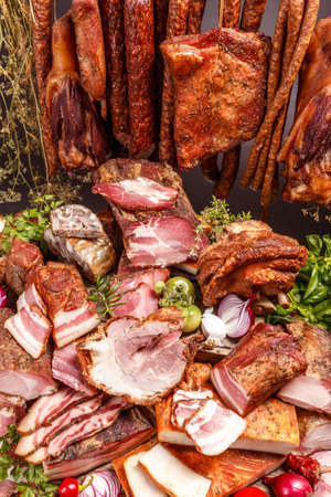 trotter: Still life of various smoked pork meat, salami and sausage