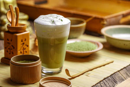 maccha: Still life with Japanese matcha accessories and matcha tea latte in glass