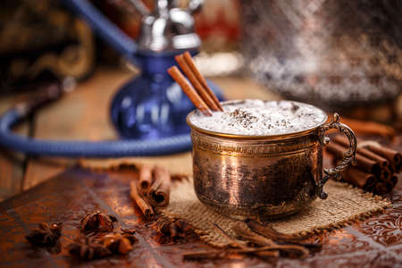 chai: Chai latte spiced tea beverage in glass with spices Stock Photo
