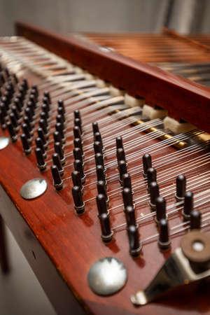 instrumentalist: Wooden dulcimer, traditional musical instrument Stock Photo