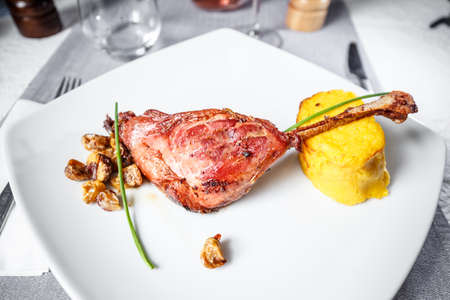 Roasted goose drumstick served with mashed potatoes and chestnuts