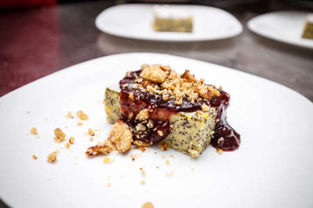 treacle: Cake made with corn flour and poppy seeds treacle with plum jam Stock Photo