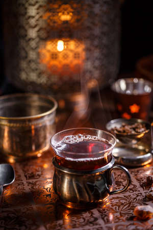 Cup of tea and aromatic candles in the dark Stock Photo