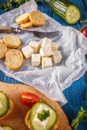 Bread rusks fine toasted with feta cheese cube Stock Photo