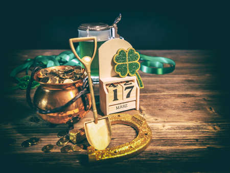St. Patricks day image with horseshoe, shamrock and pot full of gold coins