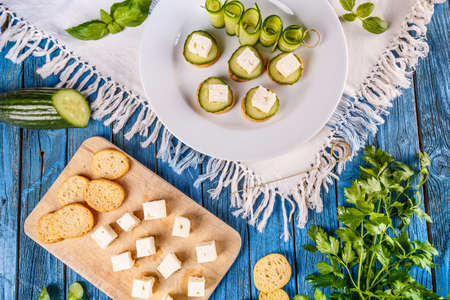 Healthy finger foods with bread rusks,  feta cheese and cucumber