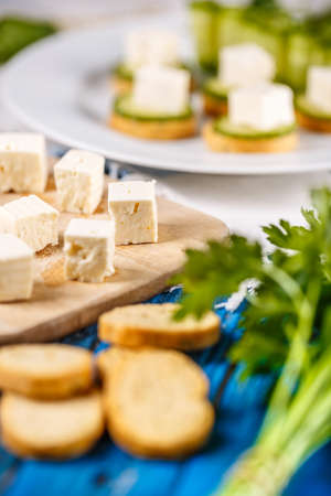 Feta cheese with bruschetta, healthy finger foods Stock Photo
