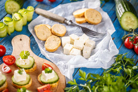 Party mini snacks, bruschetta with feta cheese and cucumber Stock Photo