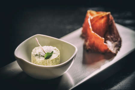 Appetizer plate in fine dining restaurant, compound butter with prosciutto Stock Photo