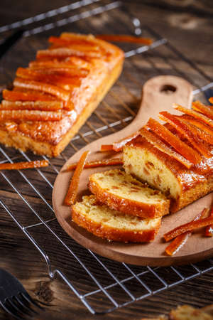 Delicious fruit loaves of bread with caramelized orange zest