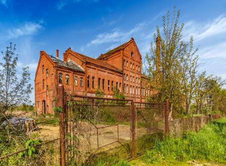 abandoned factory: Abandoned urban brick building with broken windows Stock Photo