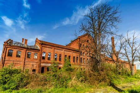 Old, abandoned and forgotten building of red brick