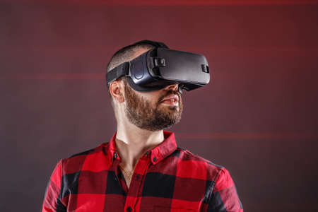Young man using VR glasses headset photo