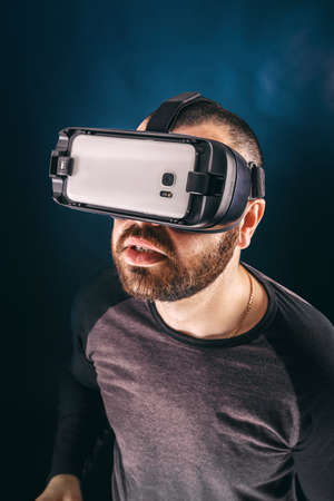 Enjoying new experience. Handsome young man in VR headset photo