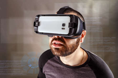 Young man experiencing virtual reality through a VR headset photo