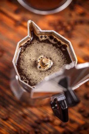 Percolated espresso coffee in a moka espresso pot