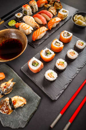 philadelphia roll: Japanese tasty sushi set on black slate