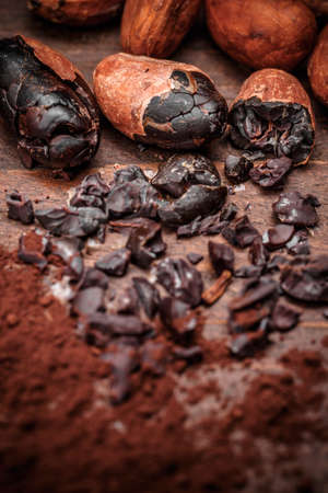 nib: Cacao nibs with cacao beans on old wooden background