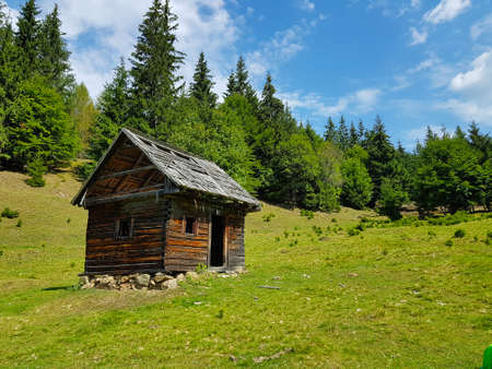 Lonely wooden house in the mountains