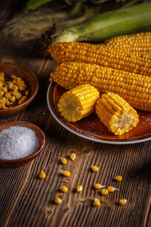 Cobs of sweet corn on a wooden table