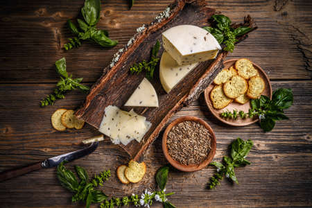 Top view of cheese wedge with caraway seeds