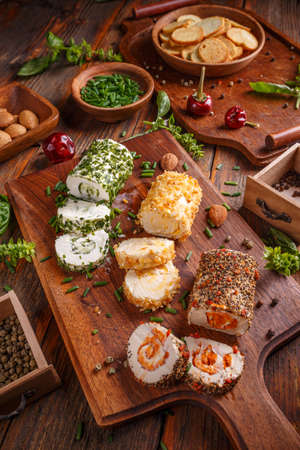 cebollines: 3 mini cheese appetizers covered with spices and chive pieces