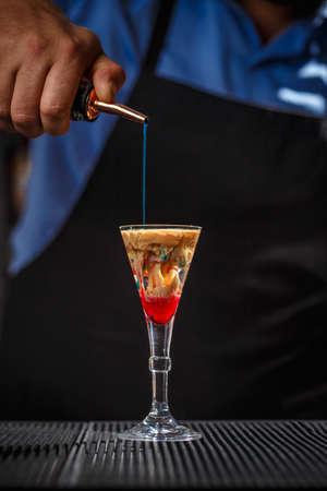 The Bartender makes Alien brain hemorrhage cocktail Stock Photo