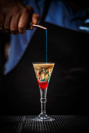 The Bartender makes Alien brain hemorrhage cocktail Stock Photo