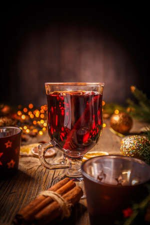 Christmas mulled wine on rustic wooden table