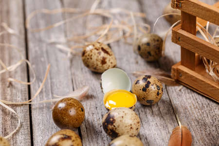 Fresh quail eggs over aged wooden background
