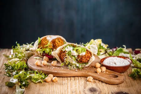 Falafel in pita bread. Tasty street food . Excellent choice for lunch or dinner. Stock Photo
