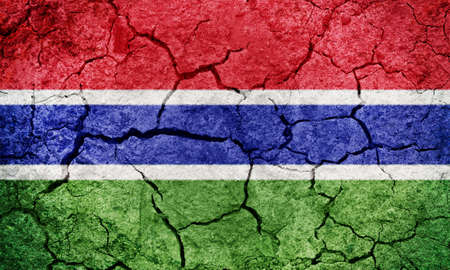 Republic of The Gambia flag on dry earth ground texture background Stock Photo