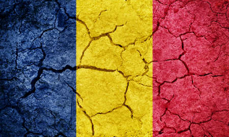 Chad flag on dry earth ground texture background Stock Photo