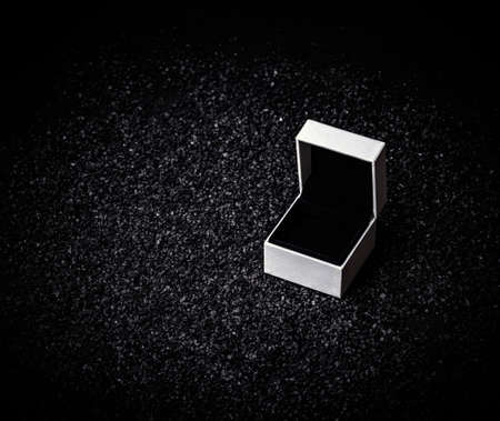 Empty white box for ring on a black background