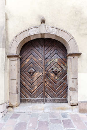 Ancient engraved wooden doors with metal knockers