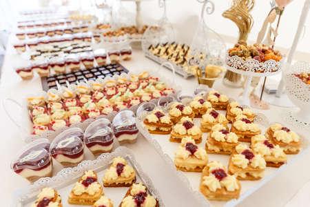 Luxury cakes on wedding dessert table in restaurant