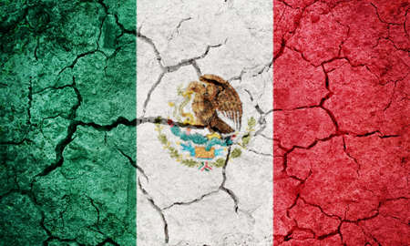 United Mexican States flag on dry earth ground texture background 版權商用圖片