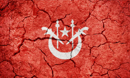Kelantan, state of Malaysia, flag on dry earth ground texture background