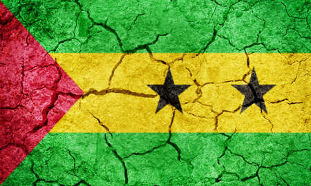 Democratic Republic of Sao Tome and Principe flag on dry earth ground texture background Фото со стока